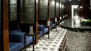 a room with a large mirror: Use credit cards like the American Express Platinum to get into exclusive airport lounges, such as the Amex Centurion Lounge at New York's JFK.