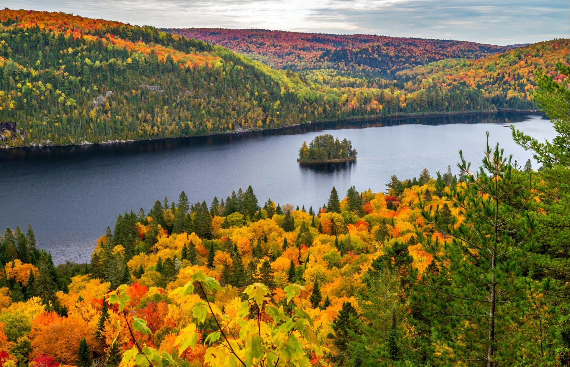Slide 24 of 31: Lake Wapizagonke sits in La Mauricie National Park, which is unquestionably one of the most beautiful places in Canada to catch the colors of fallleaves. For just a few weeks each fall the trees around the lake blaze with hues of bright orange, yellowand red. There are other lakes in the park, but Lake Wapizagonke is special in that it is so long and narrow.