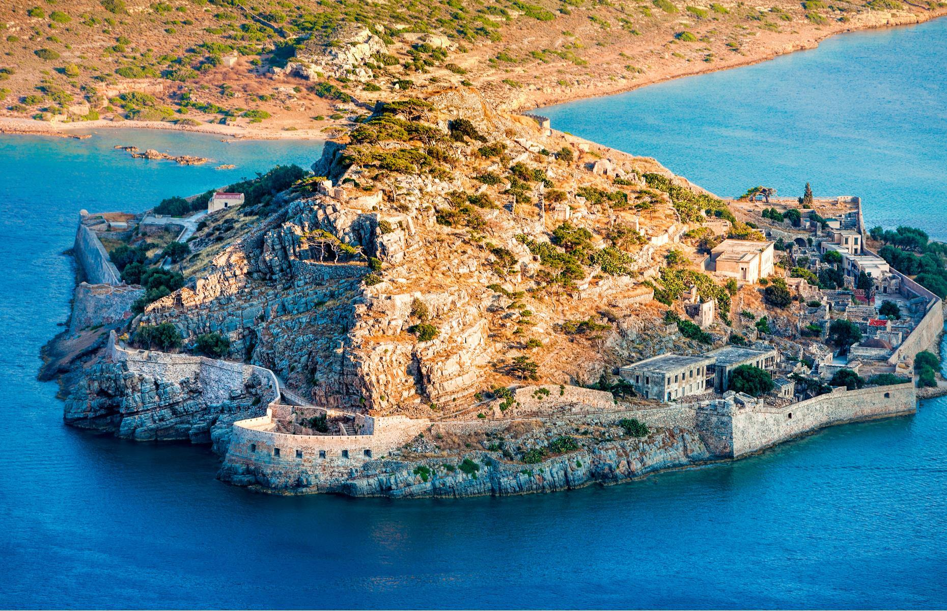 Slide 13 of 52: Bathed in sunlight and lapped by the azure waters of the Aegean, this uninhabited craggy islet off the shores of Crete might look idyllic but it hides an ugly past. From the early 1900s, the 16th-century fortress of Spinalonga was used as a leper colony. Hundreds of sufferers were banished here to live out their lives with reports that there was only a single doctor who visited only sporadically. Shrouded in tales of neglect, the colony remained in operation until 1957 andwas Europe's last leper colony.