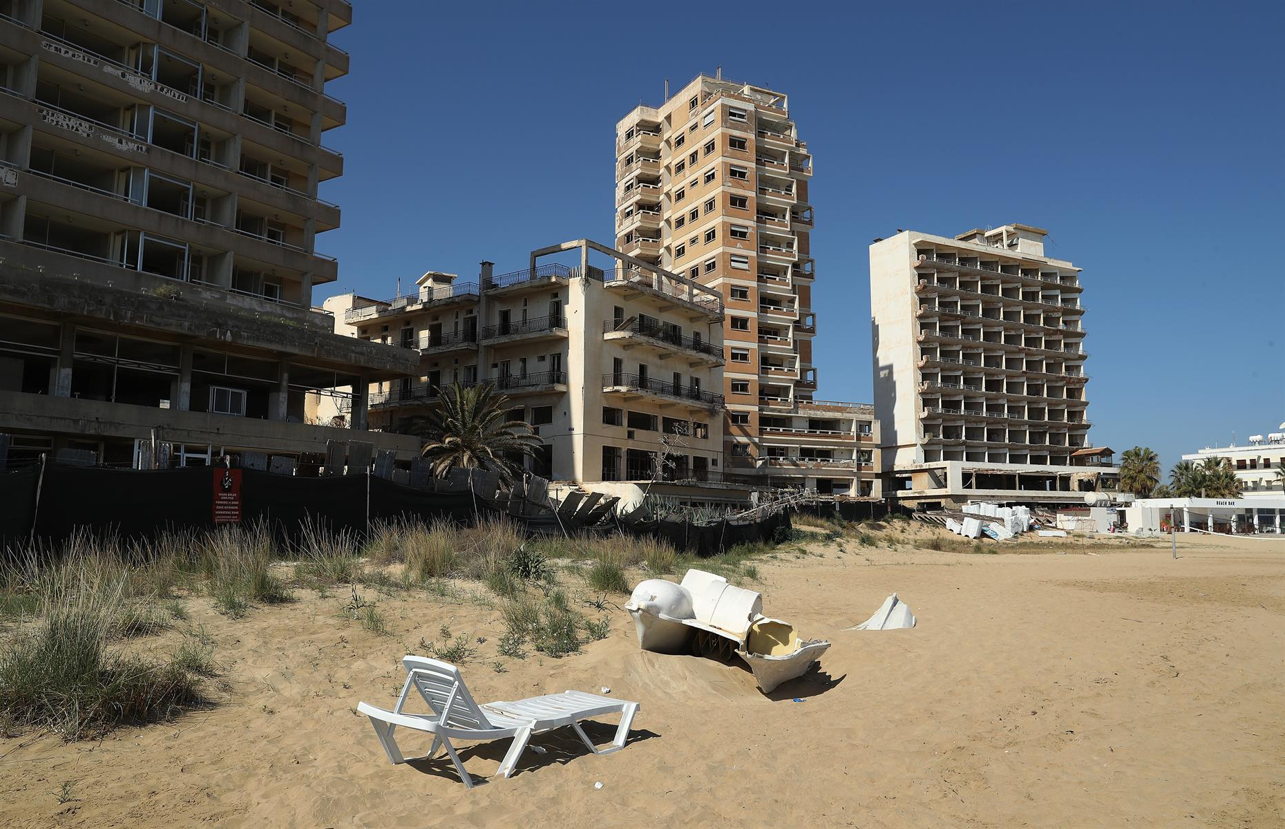 """Slide 41 of 52: Varosha lies inside the """"forbidden zone"""" of Famagusta in Cyprus and was sealed off by the Turkish military after the city's 39,000 inhabitants were forced to leave when Turkish forces invaded. After that the island was divided between Greece and Turkey and Varosha was left to its ruin."""