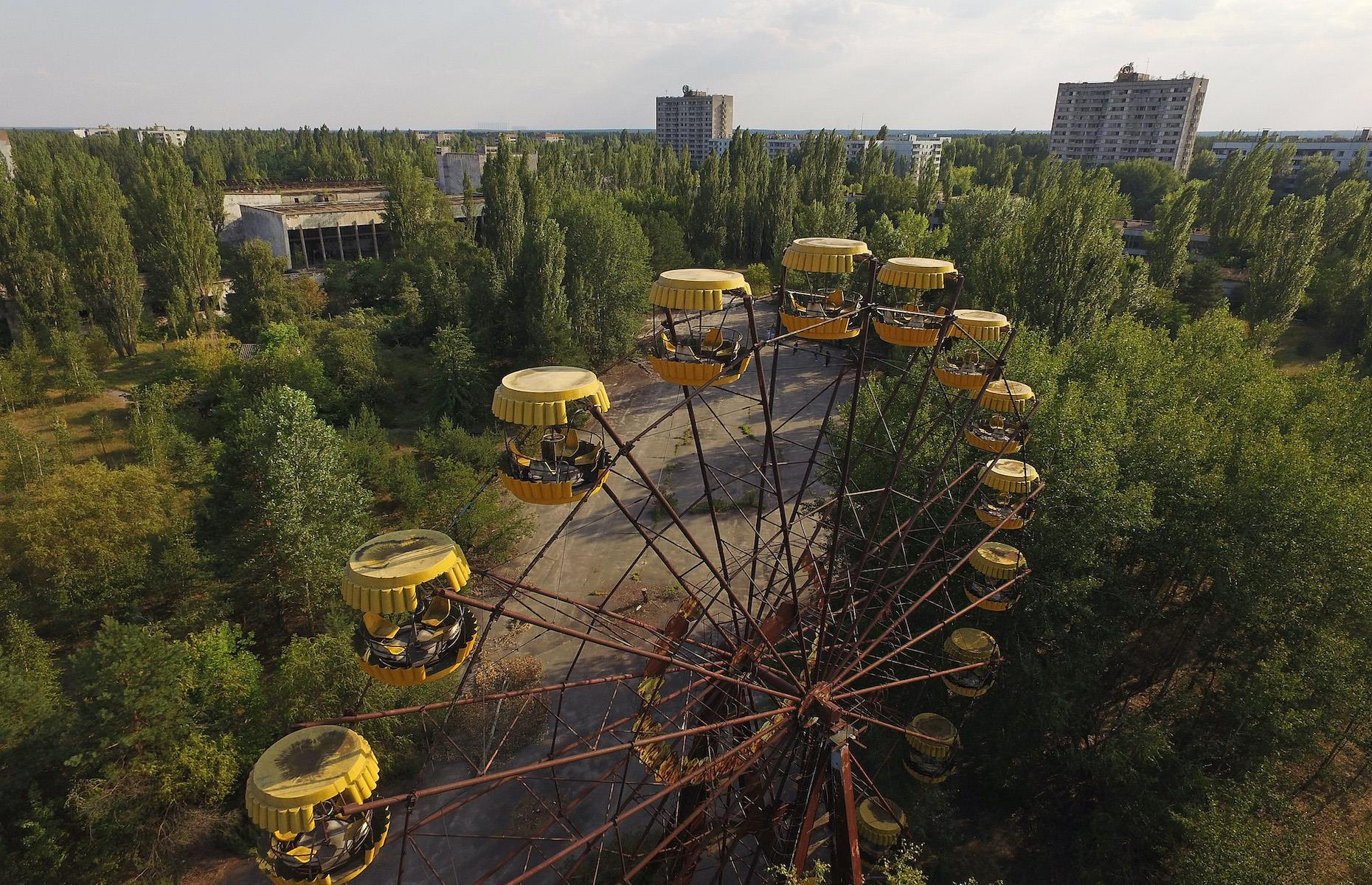 Slide 37 of 52: The Ukrainian government designated Chernobyl an official tourist attraction in 2019 after the exclusion zone was deemed safe to visit for tourists.Access is still strictly regulated by the governmentand can only be explored on guided tours. Haunting sights include the deserted school, where books and paper lie scattered on the floor of the classrooms, anda decaying amusement park. The Ferris wheel is a moving symbol of joy extinguished – it was supposed to open four days after the explosion, but never welcomed any guests. See more eerie images of abandoned amusement parks around the world.