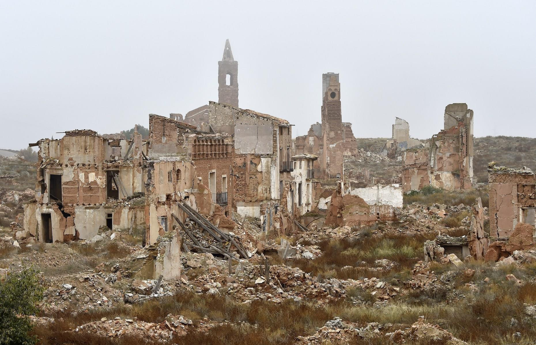 Slide 31 of 52: The remains of battle ravaged Belchite stand solemnly in Spain's Zaragoza province, acting as a poignant reminder of the horrors of the Spanish Civil War. The town was almost completely obliterated during a bloody battle over two weeks in 1937, that also claimed the lives of thousands of people. Rather than be demolished, its bullet-hole-ridden buildings, some still with intricately patterned walls and carvings, were left standing as a symbol of the past.
