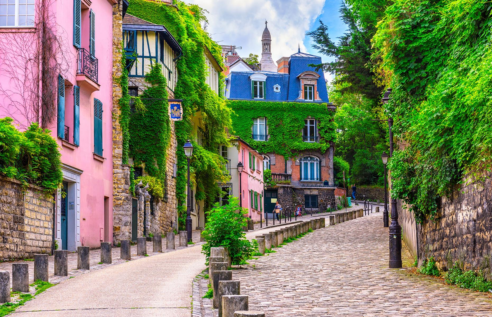 Slide 3 of 31: The French capital might be famous for sites like the Eiffel Tower and the Arc de Triomphe, but there's a lot more to the city and its distinctive arrondissements (administrative districts). From the ancient, narrow lanes of Marais to the charm of Montmartre's cobbled streets (pictured), Paris has many faces to it that are equally striking in every season.