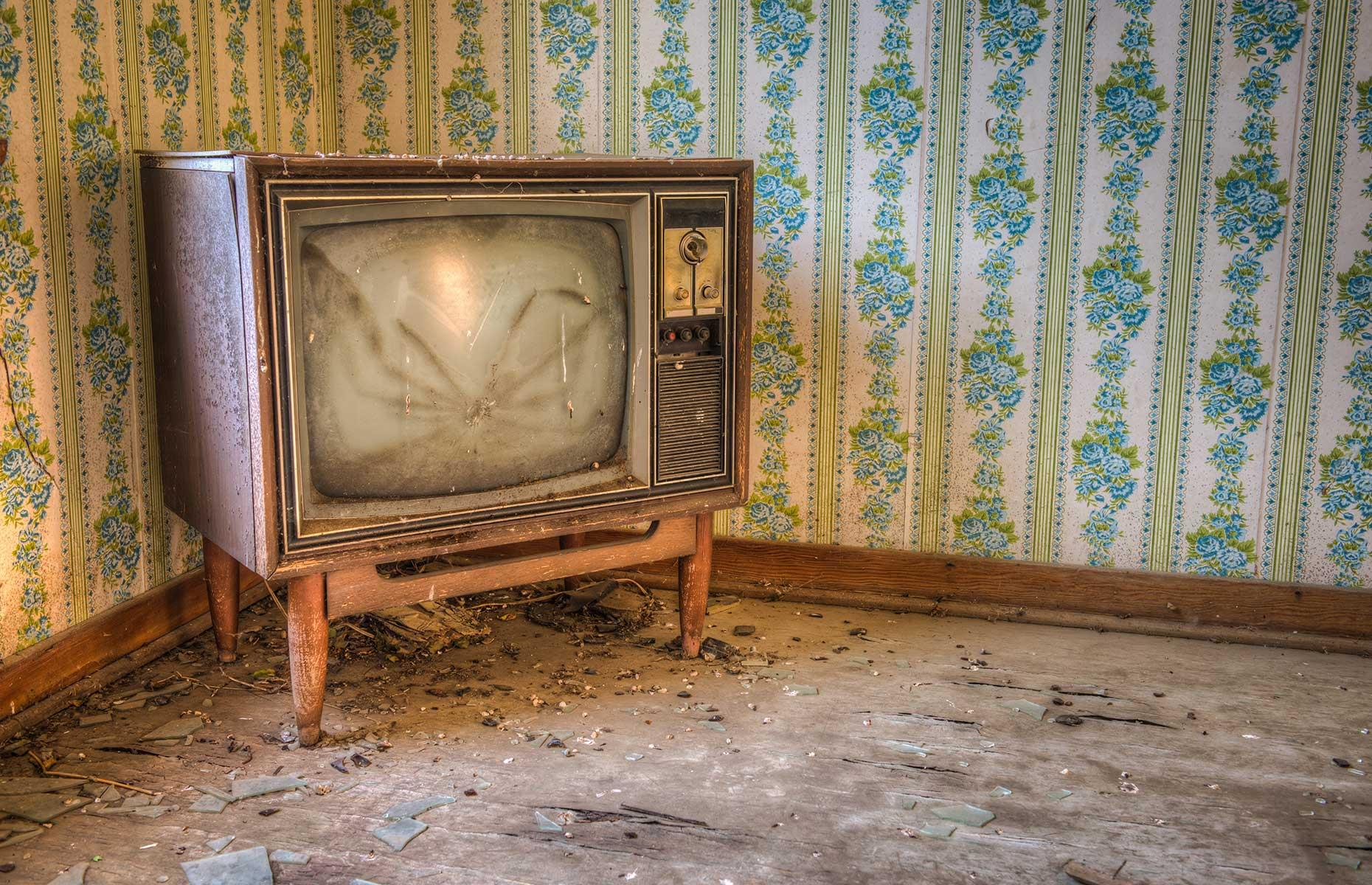 Slide 32 of 32: In addition to a community hall there are several homes still standing too. In one, sits this incredibly creepy TV set, with a spider-like smashed screen. Here are 50 other reasons to fall in love with Canada
