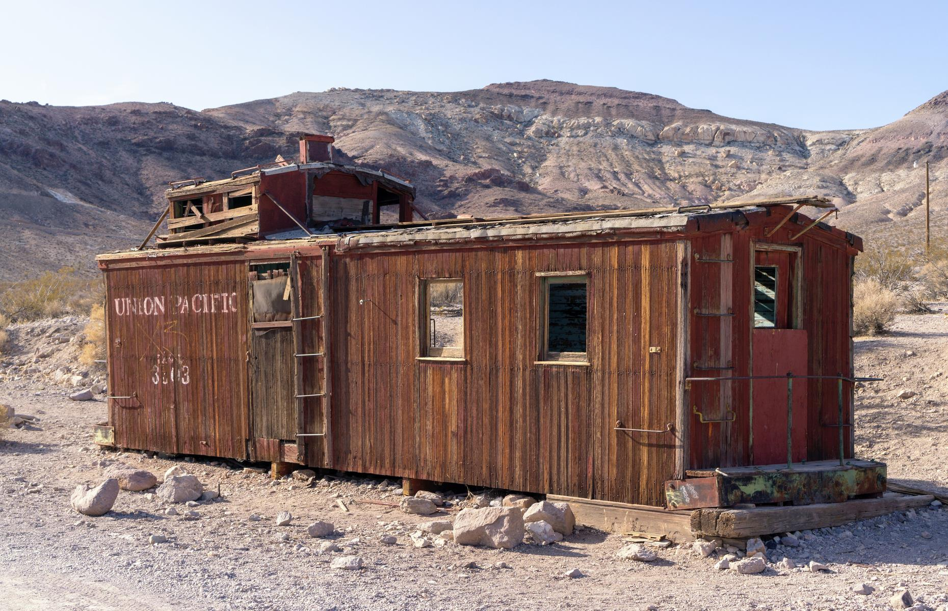 Slide 30 of 52: Situated just outside the boundaries of Death Valley National Park, Rhyolite is Nevada's most intriguing ghost town. Prospectors found quartz in the area as early as 1904 and a town filled with stores, houses, a school and even hotels soon bloomed. Its success was fleeting though: by 1910, business began to decline and by 1916 Rhyolite was completely abandoned. Today reminders of the town's existence pop up across the stark landscape, from parts of an old jail to a decrepit bank building.
