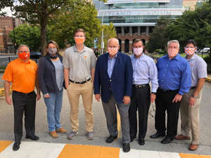 a group of people posing for the camera: Cherokee Distributing Company and the Vol Network celebrate renewal of their partnership at Neyland Stadium on the University of Tennessee (UT) campus this fall. Pictured from left: Vol Network General Manager Steve Early; UT Senior Associate Athletics Director Jeneen Lalik; Cherokee Distributing Company Off-Premise Manager Burton Sampson; UT Director of Athletics Phillip Fulmer; Cherokee Distributing Company General Manager Jeff Knight; Cherokee Distributing Company Director of Sales Dwayne Light; and Vol Network Executive Director Glenn Thackston.