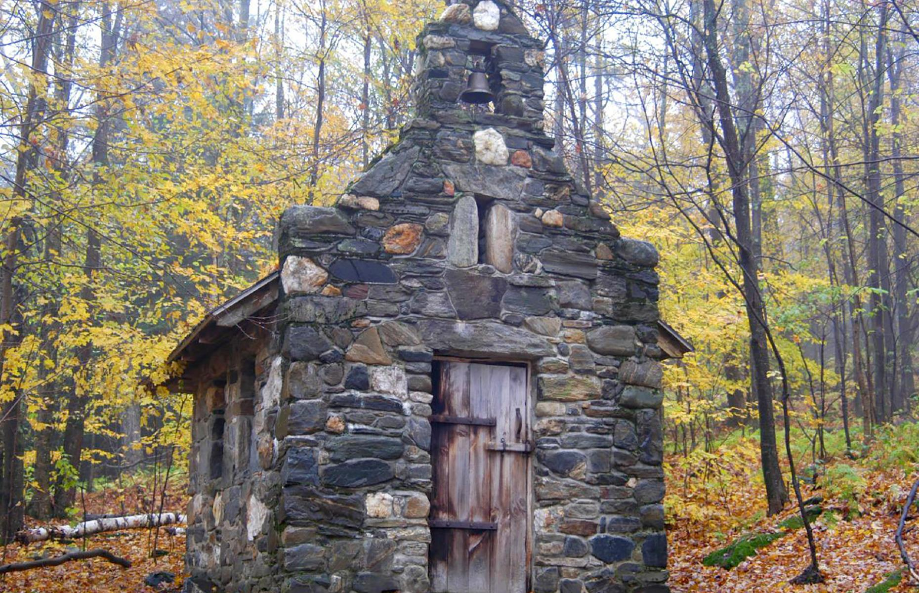 Slide 47 of 52: Compared to the many fading ghost towns in the USA's west, Vermont has few abandoned buildings, but a dinky stone chapel can be found in the wooded grounds of the Trapp Family Lodge in the pretty town of Stowe. The Austrian-style lodge is still owned and operated by the von Trapp family, who moved to Stowe in the 1940s and opened this property to guests in 1950. A hike through the grounds leads to the picturesque chapel, reportedly built as a tribute to Second World War soldiers.