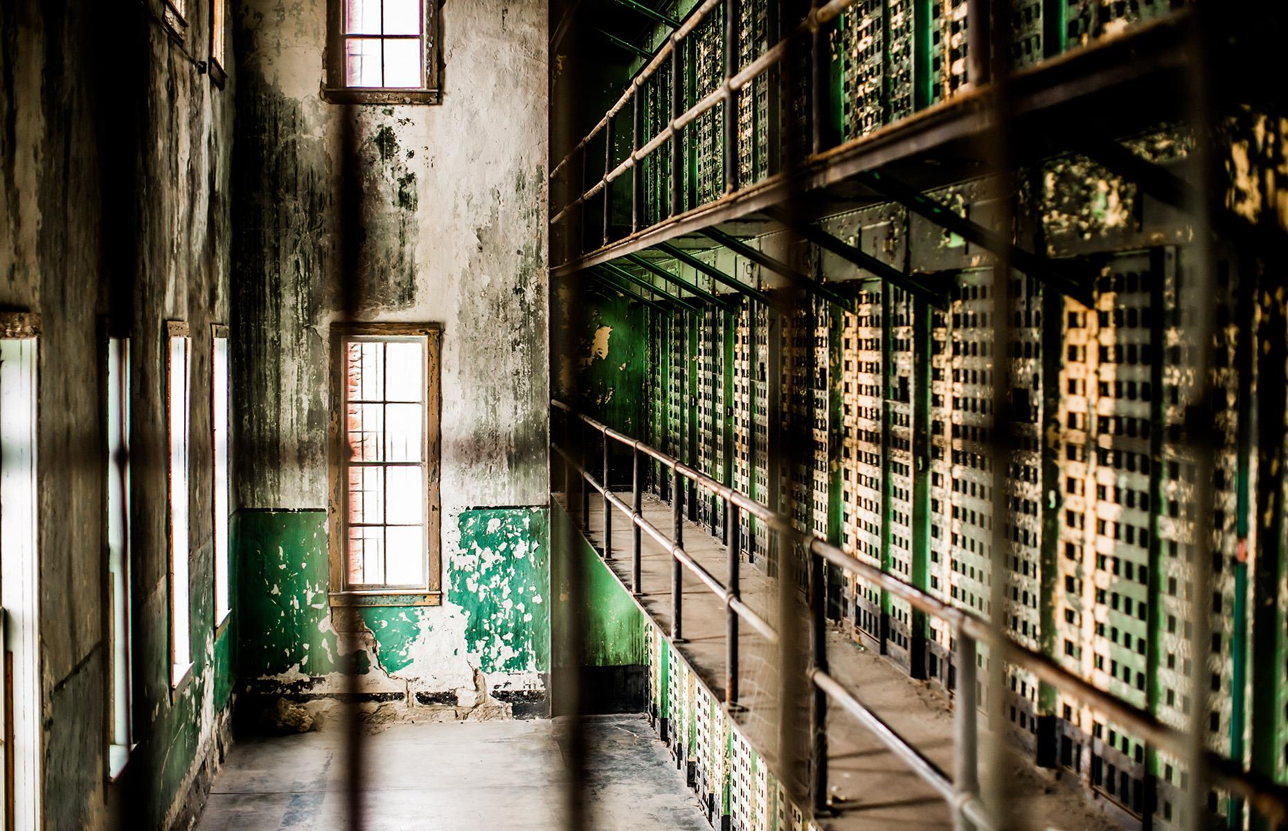 Slide 14 of 52: The creepy corridors and creaking cell blocks of the Old Idaho State Penitentiary were built in the early 1870s and, during the prison's century in operation, some of the state's most formidable criminals were incarcerated here. But by the 1970s the prison was outdated, with poor sanitation and inadequate space for the constant influx of inmates. The prisoners were transferred elsewhere, and the facility was finally closed. Today, the site is preserved by the Idaho State Historical Society and self-guided tours are currently available – visitors are encouraged to book in advance and are required to wear a mask.
