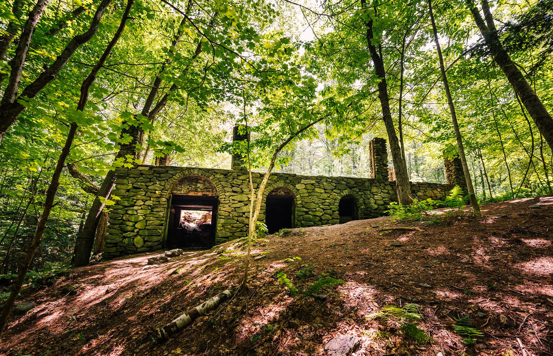Slide 31 of 52: Swallowed up by the Madame Sherri forest, these enchanting ruins have a tale to tell. The castle was once owned by eccentric Madame Sherri, a costume designer with a penchant for lavish parties. It began to crumble away after Madame Sherri left the property behind, and was all but destroyed by a fire in 1962. Still standing are some of the castle's stone walls, carved out with arches, and a swirling stairway. Hikers can see the ruins on an easy trail through the forest – check safety advice before you go.