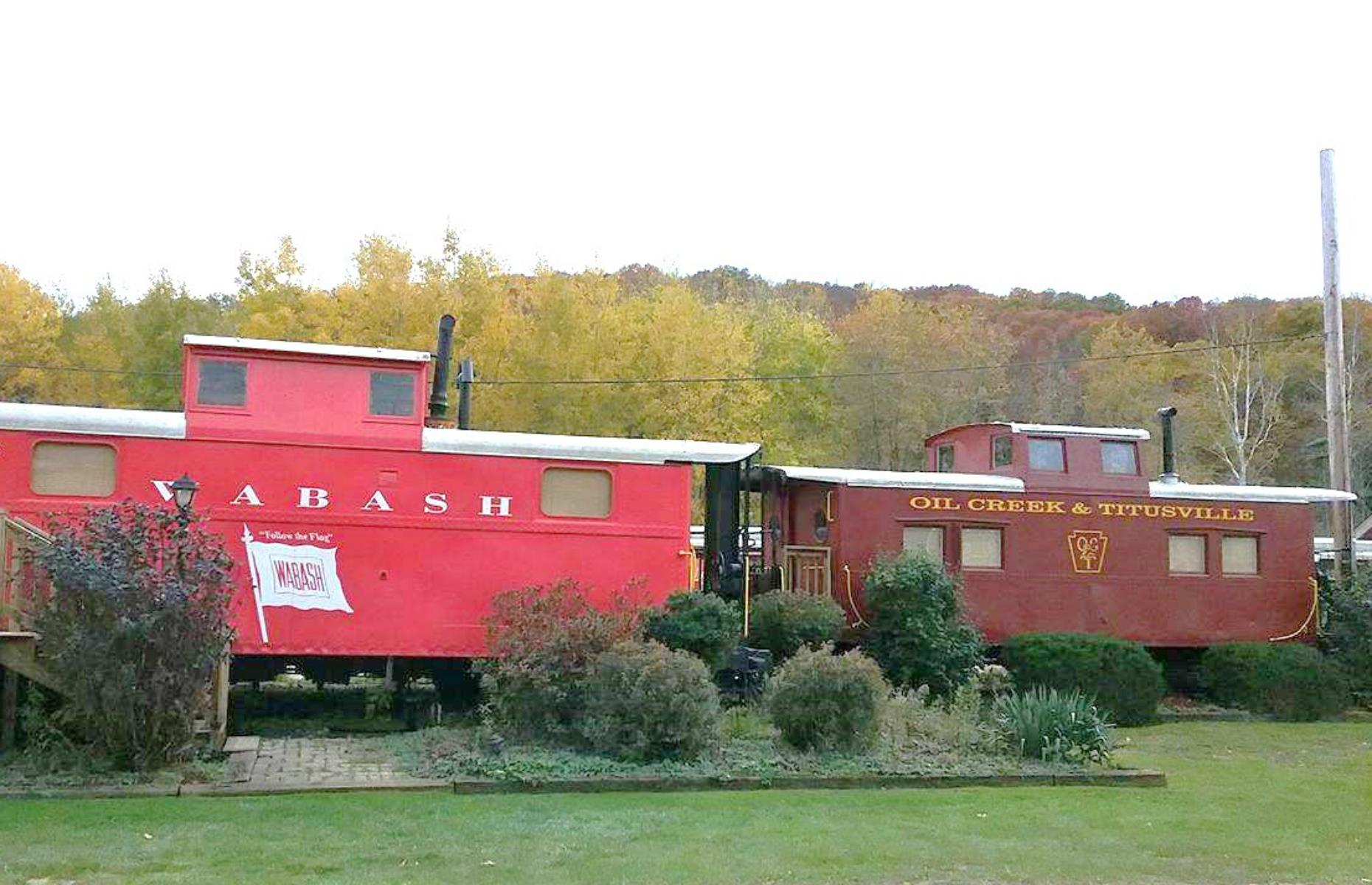 Slide 40 of 52: Spend the night on the tracks at the Caboose Motel, where 21 caboose railroad cars have been converted into cute, individual cabins. Each has twin beds or a king-size and a bathroom with shower, plus domed or bay windows so guests can gaze out and pretend they're on a glamorous journey. They also have deck chairs on the platform, while the cars have easy access to the 9.6-mile (15.4km) Oil Creek State Park trail. The season is from April to October each year.