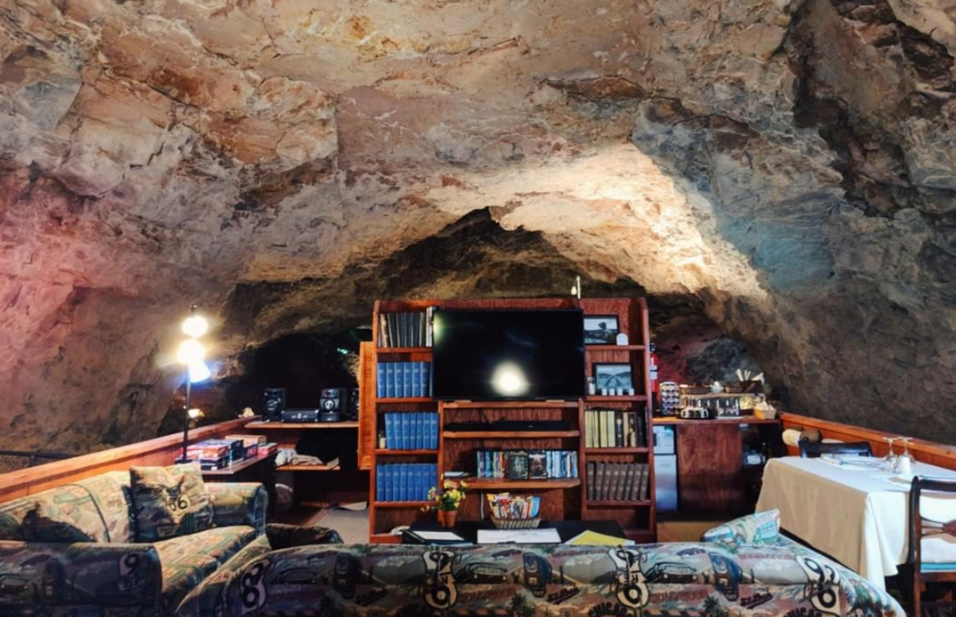 Slide 4 of 52: Billed as the largest, deepest and darkest motel room in the world, the Underground Cave Suite is not for the faint-hearted. It's tucked 22 stories below the Grand Canyon and is surprisingly luxurious, with a flatscreen TV, library of old books and magazines, record player and comfy couches – all with walls that are around 65 million years old. There are rooms available above ground too – though this one is definitely the most fun.