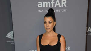Kourtney Kardashian posing for a picture: Kim isn't the only Kardashian to be robbed as her older sister Kourtney's home in Calabasas was burgled in 2009. The reality star lost $100,000 worth of jewellery and other sentimental possessions whilst her home security system was down. Kourtney and the family claimed the thief must have been someone they knew to know when to target the house.