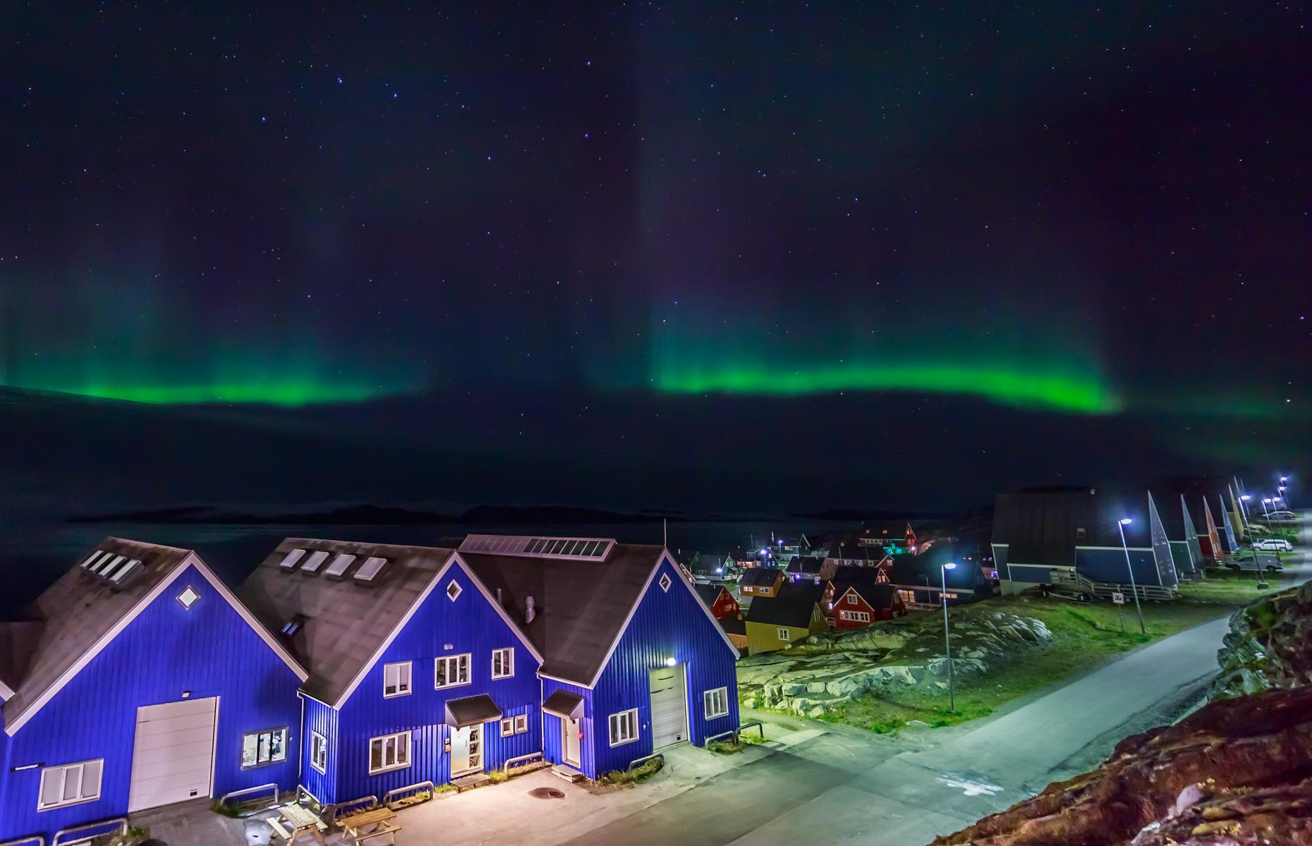 Slide 13 of 25: What's more, because Greenland's settlements are so sparsely-populated – from the capital, Nuuk, pictured, home to 57,000, and the second-largest city, Sisimiut, home to just 5,400 – you needn't travel far from civilization to be in with a chance of seeing the Northern Lights.