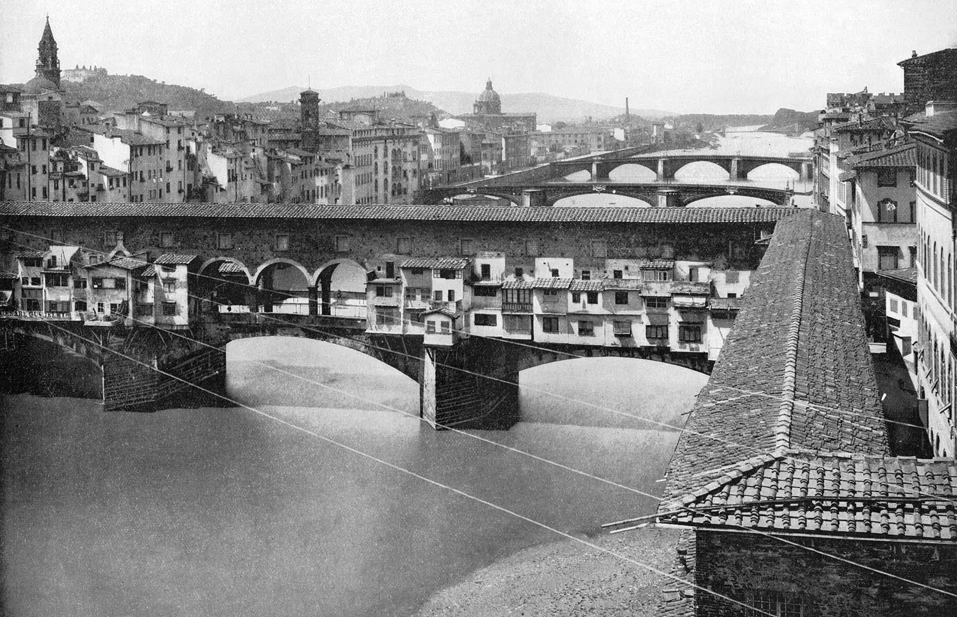 Slide 16 of 27: A city with a long and illustrious history, Florence needs no introductions. Its famous Ponte Vecchio is captured here in 1893, just 22 years after Rome replaced the city as the capital of the Kingdom of Italy. During the Second World War the city was under a year-long German occupation and as the British troops closed in, the Germans had plans to destroy all of the bridges along the Arno river in 1944, including Ponte Vecchio. Thankfully, a consul managed to convince a German general to spare the bridge due to its historic value.