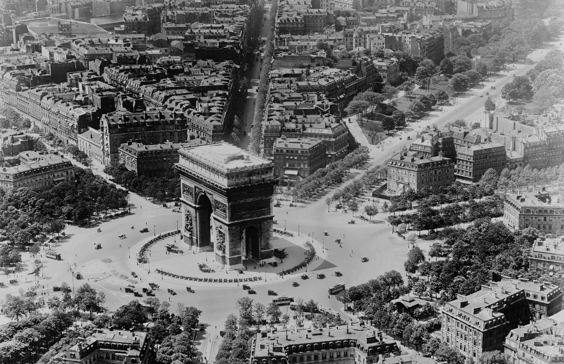 Slide 24 of 27: Arc de Triomphe, officially called Arc de Triomphe de l'Étoile, is one of the French capital's most famous sights, commemorating the French soldiers who fought and died in the French Revolutionary and Napoleonic Wars. Snapped in the first half of the 1900s, around 100 years after the landmark was finished, this aerial photo also gives a good glimpse of what the city used to look like, including the tree-lined avenues that surround it.