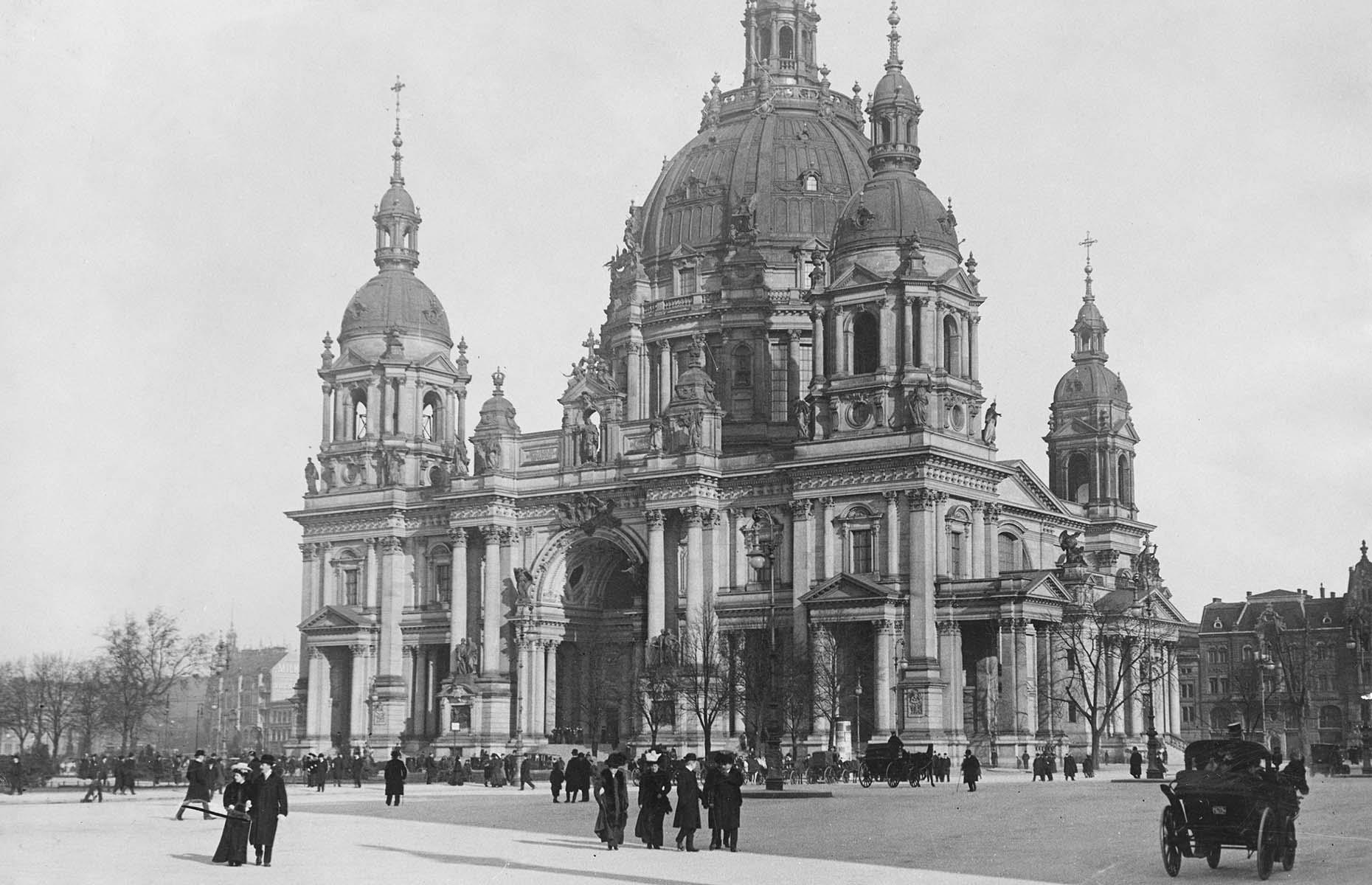 Slide 12 of 27: Consecrated in the 15th century, the Berlin Cathedral, pictured here circa 1890, has had multiple iterations. A significant Berlin landmark both then and now, it was badly damaged in the Second World War and its reconstruction didn't start until 1975. Around the time when this photo was taken, Berlin had become the capital of the newly founded German Empire, which inspired rapid growth and expansion in the city. This, combined with the damage of two World Wars, means it's unsurprising that the city's face has changed so dramatically...