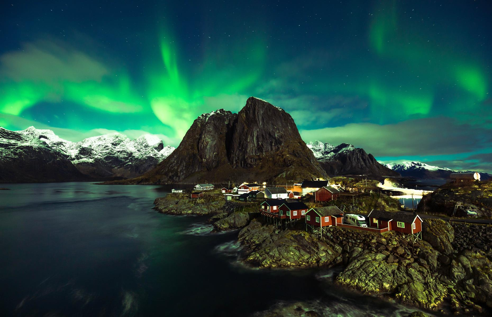 Slide 22 of 25: In Norway's Lofoten archipelago, a serene island chain sits proudly within the Arctic Circle, offering jagged peaks, calm waters and picturesque fishing villages like Hamnøy (pictured). From here the Northern Lights are a frequent sight from August to October. Now check out these 13 unexpected places where you can see the Northern Lights.