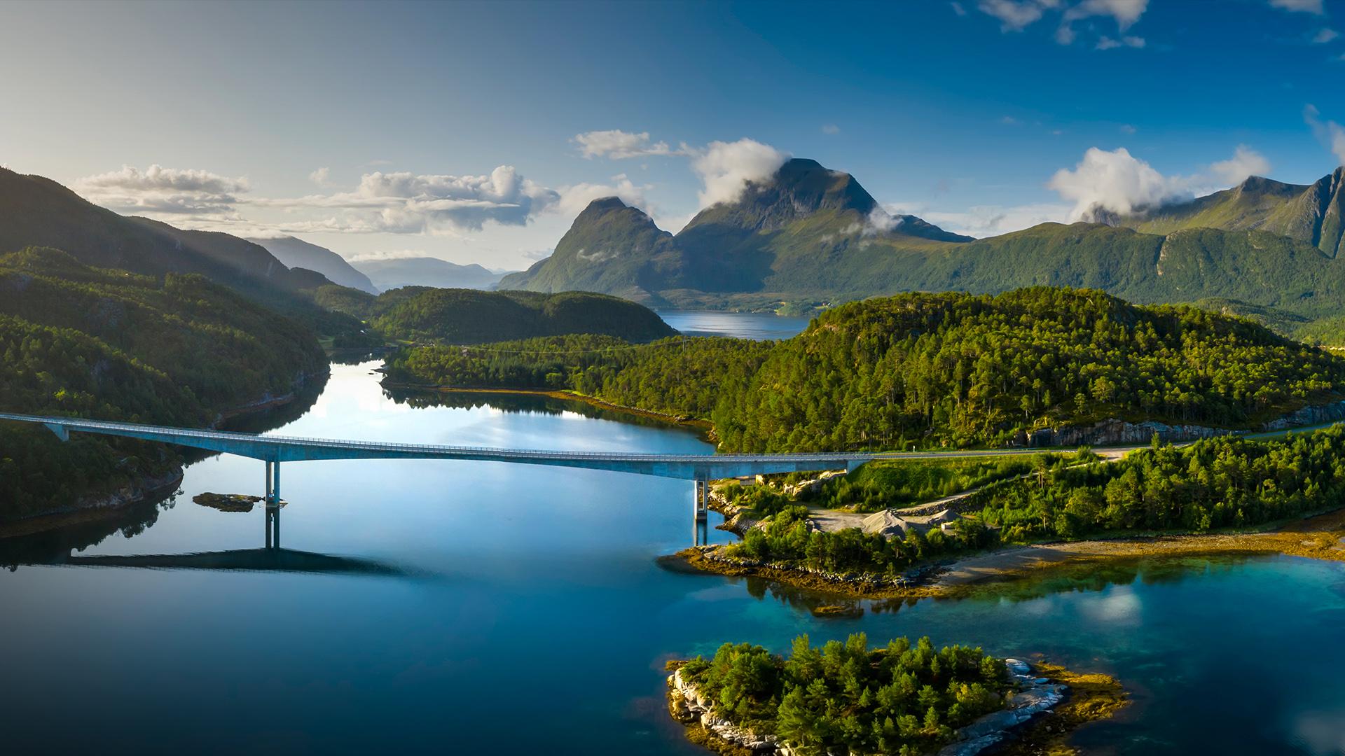 Slide 17 of 41: Beautiful Norwegian fjord at sunrise. Aerial view