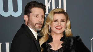 Brandon Blackstock, Kelly Clarkson looking at the camera
