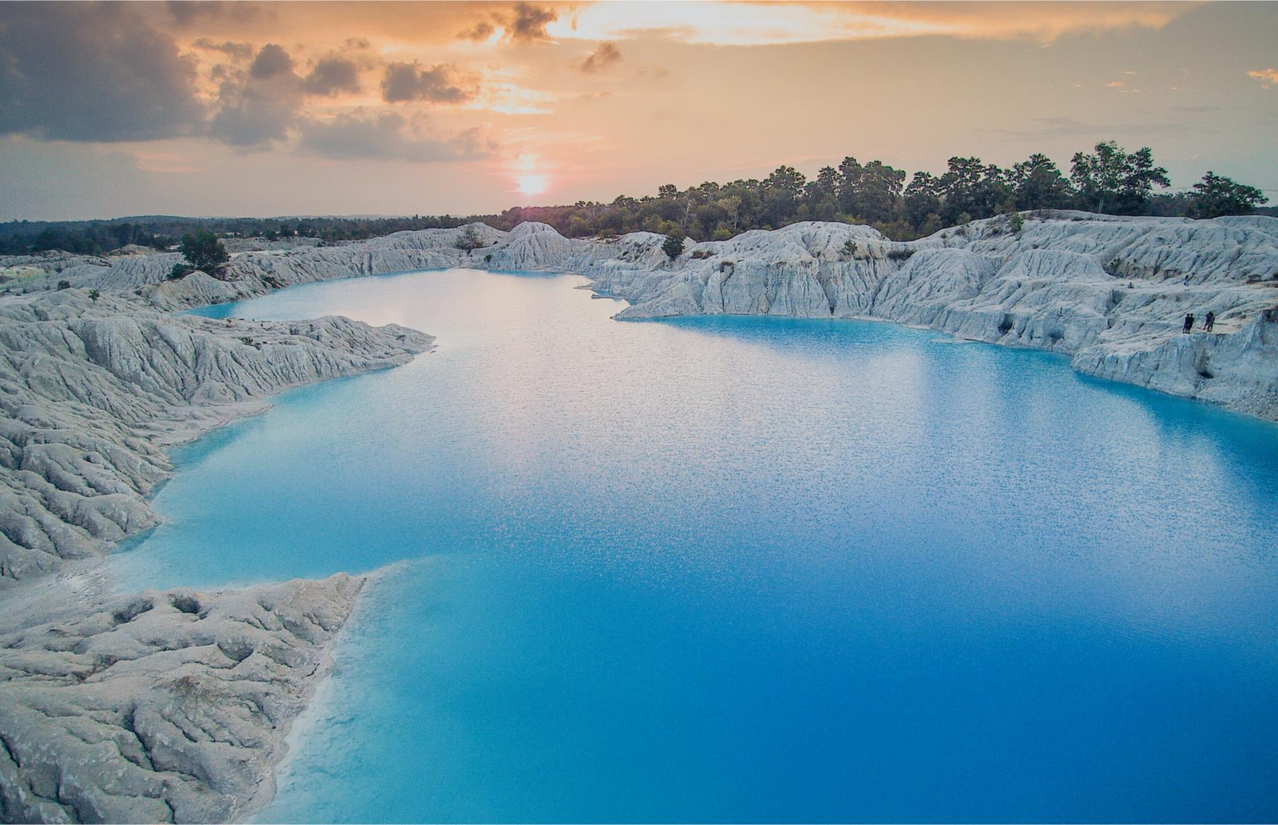 Slide 28 of 31: Indonesia's striking Kaolin Lake is an abandoned quarry which was built to collect industrial minerals needed for cosmetics, toothpaste and paper production, and later flooded. Located on the island of Belitung, its dazzling turquoise expanse is surrounded by mountains of excavated white rocks. Swimming in its waters is reputed to have health benefits.