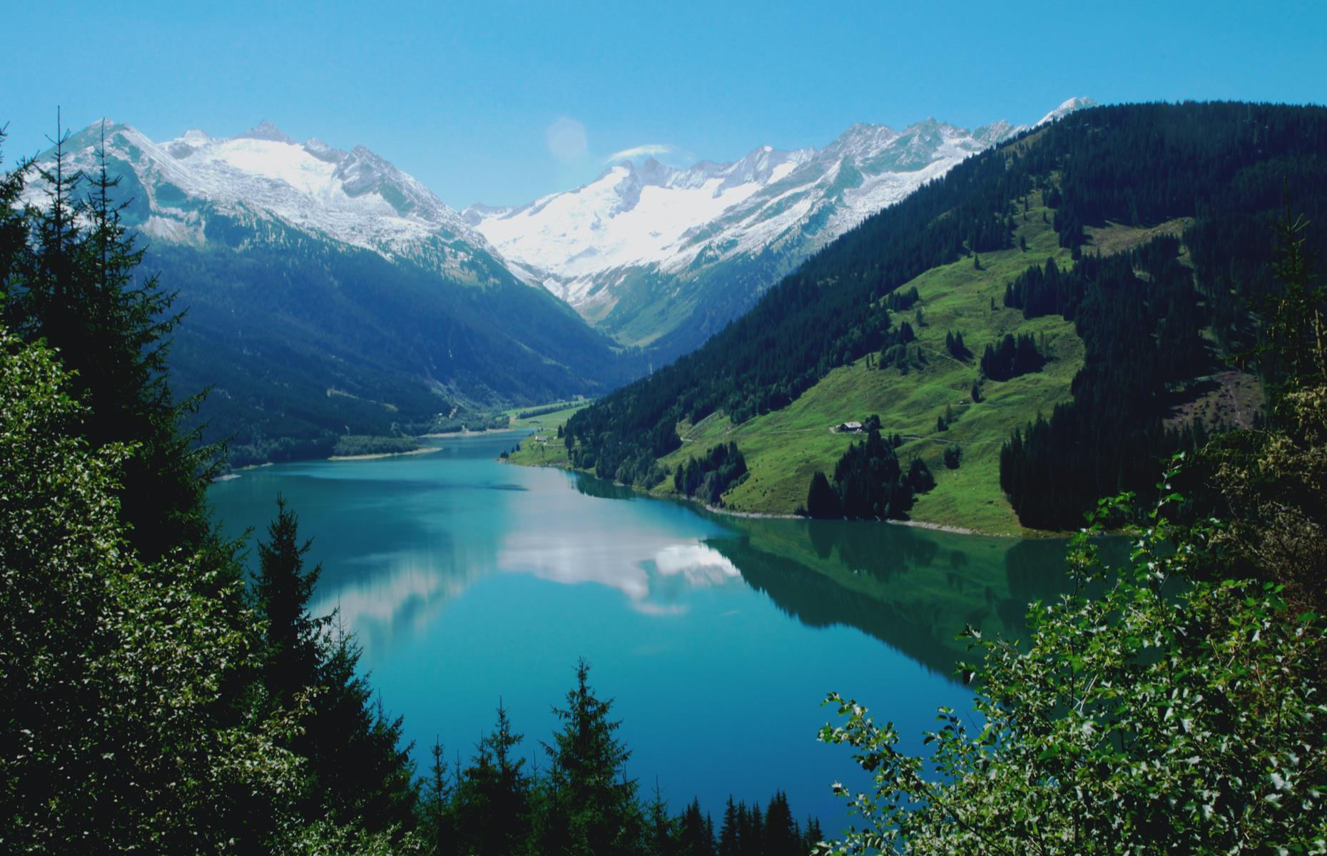 Slide 31 of 31: Surrounded by the Zillertal Alps and the Reichenspitz mountain range, the stunning Durlassboden Basin stretches between the Austrian states of Tyrol and Salzburg. The high-altitude reservoir (4,593ft/1,400m) is usually a hive of activity with hikers and cyclists doing the circuit around the water (there are cozy mountain restaurants to refresh along the way) or venturing further up in to the mountains. The lake is a lovely spot for swimming and watersports too, and lays claim to having the highest sail and surf school in Austria.
