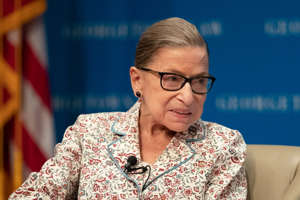 Ruth Bader Ginsburg wearing glasses talking on a cell phone: Supreme Court Associate Justice Ruth Bader Ginsburg speaks about her work and gender equality during a panel discussion at the Georgetown University Law Center in Washington, Tuesday, July 2, 2019.