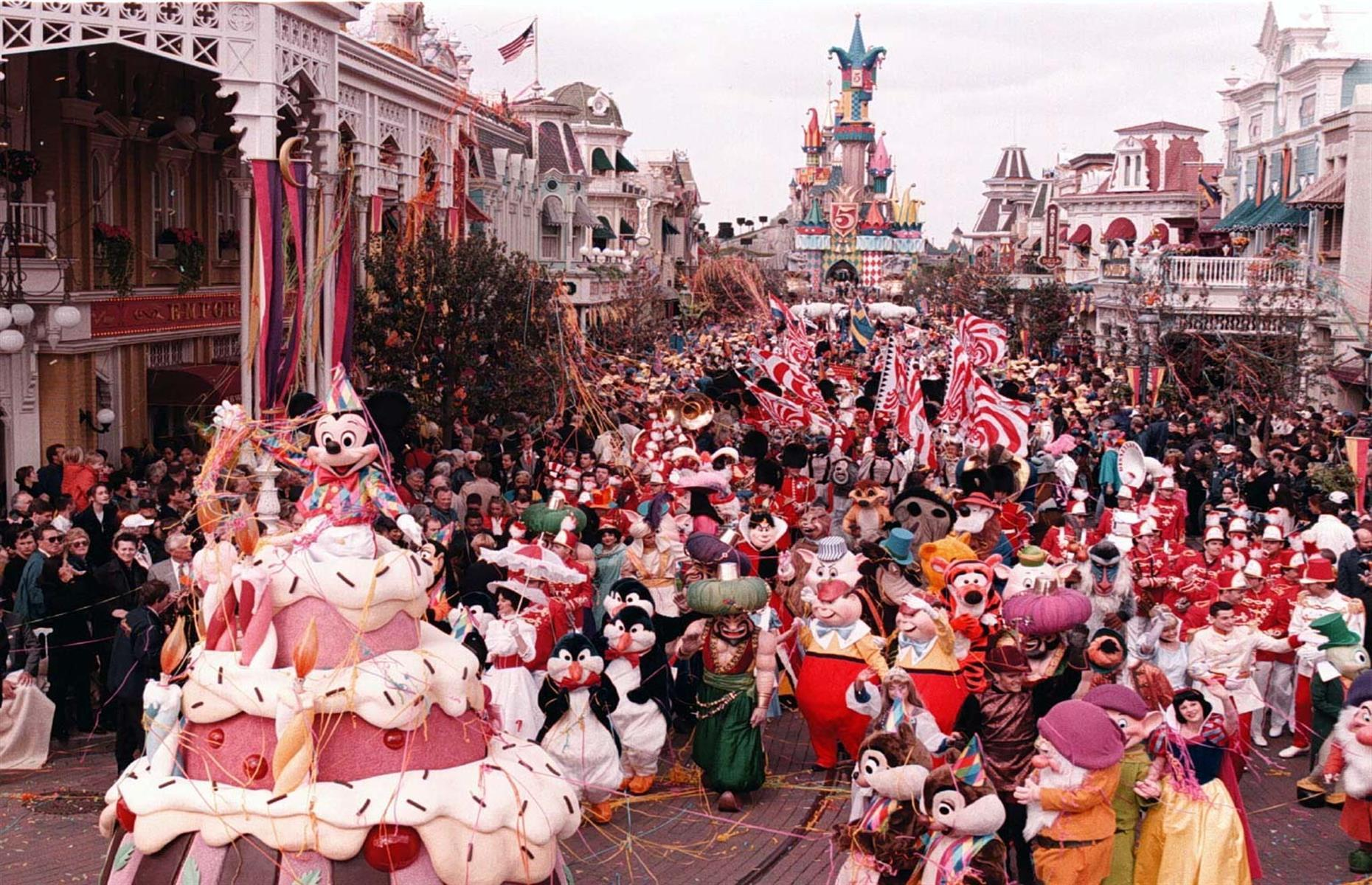 Slide 33 of 38: In 1992, Disney came to Europe with the opening of Disneyland Paris (then Euro Disney Resort). Brits and holidaymakers from the Continent flocked to the magical park throughout the decade, and a trip to Euro Disney became the vacation of dreams for the Nineties kid. In this 1997 photo, the park is filled to the brim as colorful celebrations for its fifth birthday are in full swing. Love this? Now discover how air travel has changed in every decade from the 1920s.