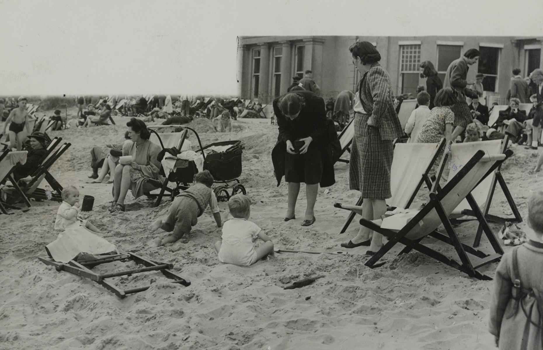 Slide 6 of 38: Across the pond, vacations unfolded in much the same way as they did in the States during the 1940s. This snap shows bathers and beach-baskers on South Sands in Devon at the tail end of the war, not long after the spot had been reopened.