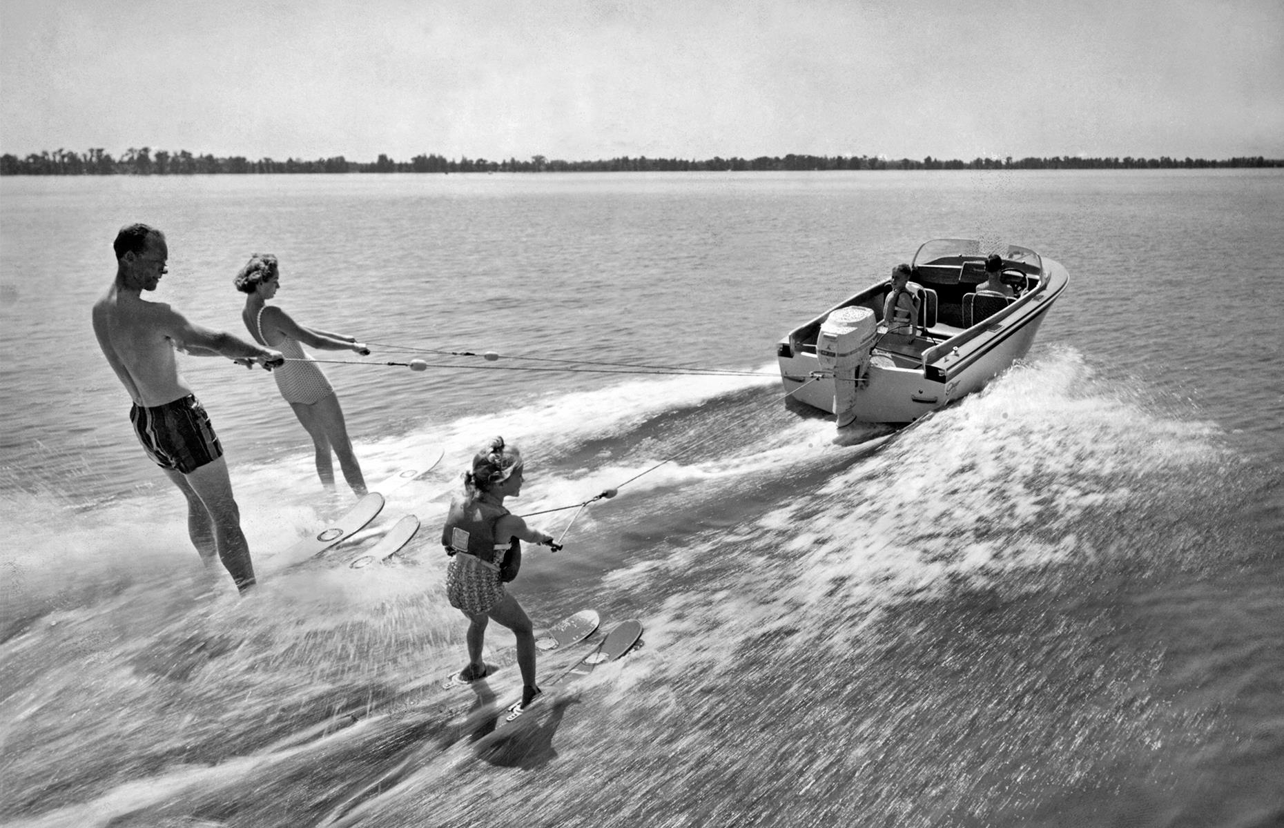 Slide 10 of 38: Tourism boomed in the Sunshine State in this post-war decade, with sun-seekers flocking here from all over America. Top destinations included Miami, St Petersburg and St Augustine. This water-skiing family was snapped in Winter Haven's Cypress Gardens, often tipped as Florida's first theme park. Now see Florida's incredible transformation from swampland to vacation paradise.