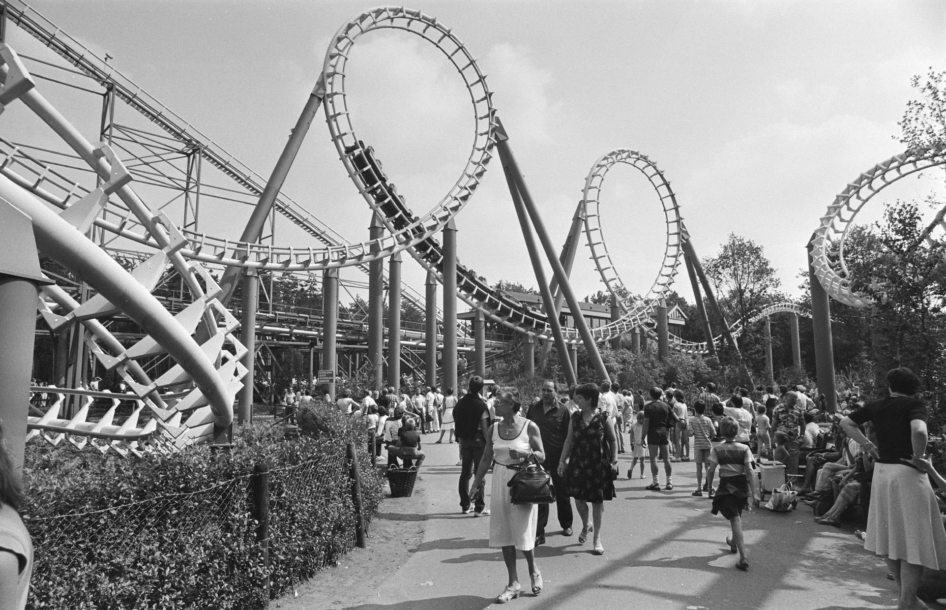 Slide 32 of 38: It wasn't just America's larger-than-life theme parks that were drawing family travelers, either. The Netherlands' Efteling – often tipped as one of Europe's greatest theme parks – drew scores of tourists too. Opened in the Fifties, the park was booming by the Eighties, and this shot shows families wandering through the site, dwarfed by the titanic loops of the Python roller coaster.