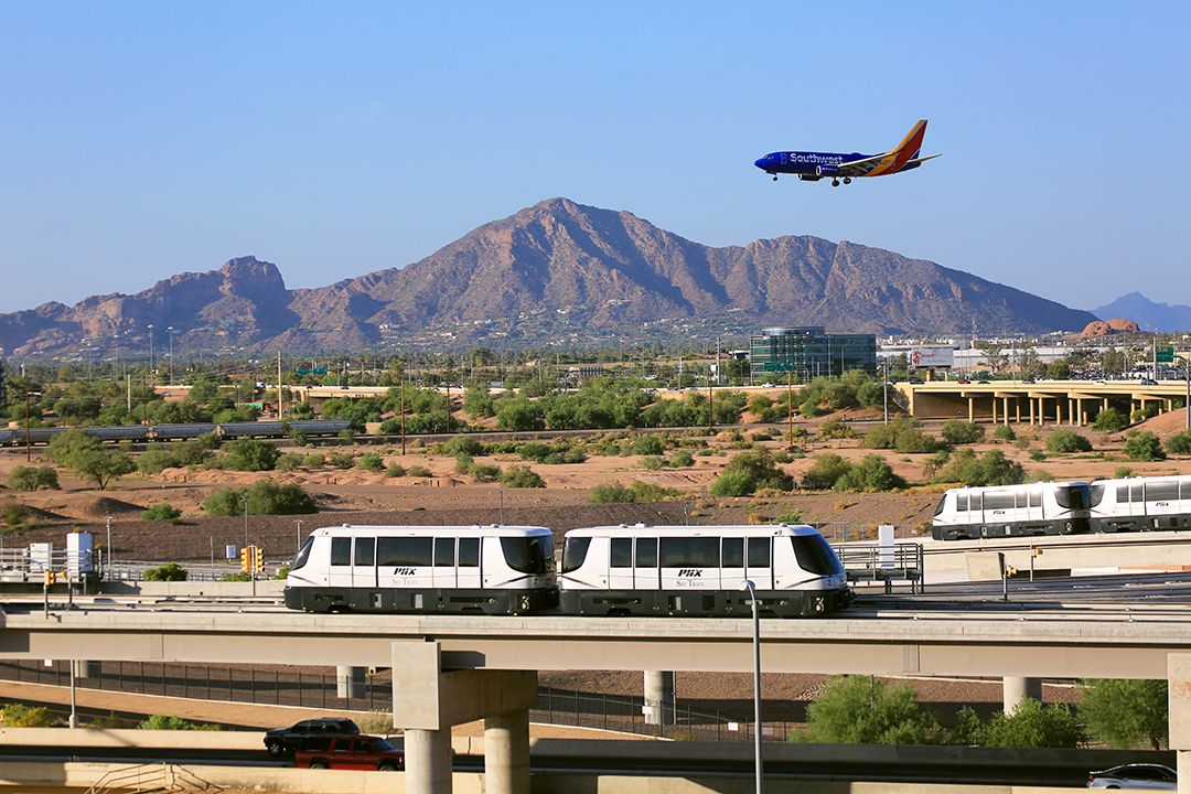 Slide 4 of 51: Love watching planes land and take off? Get on board the PHX Sky Train. Located at the Phoenix Sky Harbor International Airport, the trains cross over an active airport taxiway. It's the first system in the world to do this!