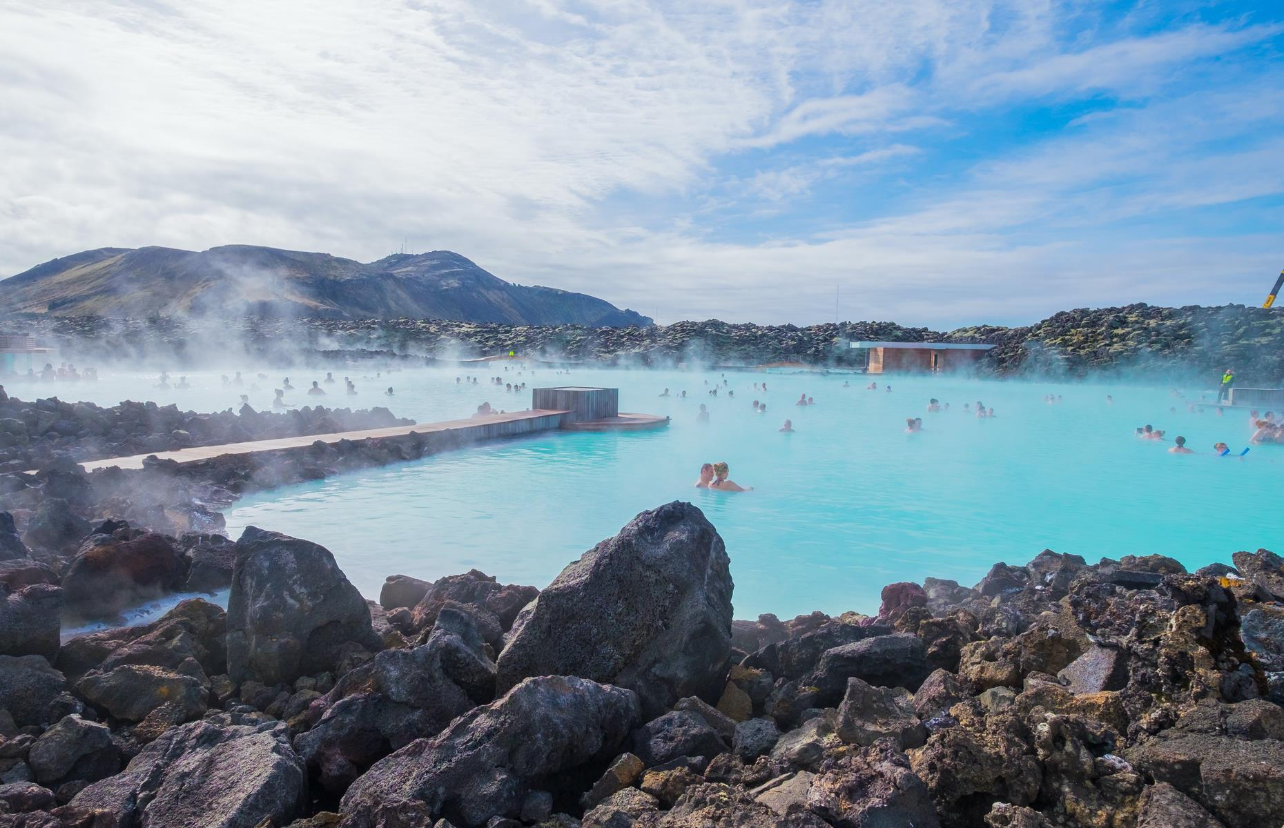 Slide 19 of 31: Iceland is packed with natural wonders but one of its most well-known sights, the Blue Lagoon, is actually man-made. In fact, the geothermal spa which is rich in minerals, was formed in 1976 by accident – it's actually wastewater produced by a nearby power plant. People began bathing in the warm waters in the early 1980s and discovered its benefit for skin conditions. It was officially opened to the public in 1992. The lagoon's distinct blue waters are caused by its high silica content which reflects the light. Check out more of the world's colorful places.