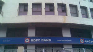a sign on the side of a building: HDFC Bank's digital outages: 7 key takeaways from RBI action