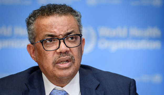 Tedros Adhanom Ghebreyesus wearing a suit and glasses smiling for the camera: The news comes as the World Health Organization (WHO) have shared concerns regarding a new variant, named 'Mu', which could be dangerous. Pic: FABRICE COFFRINI/AFP via Getty Images