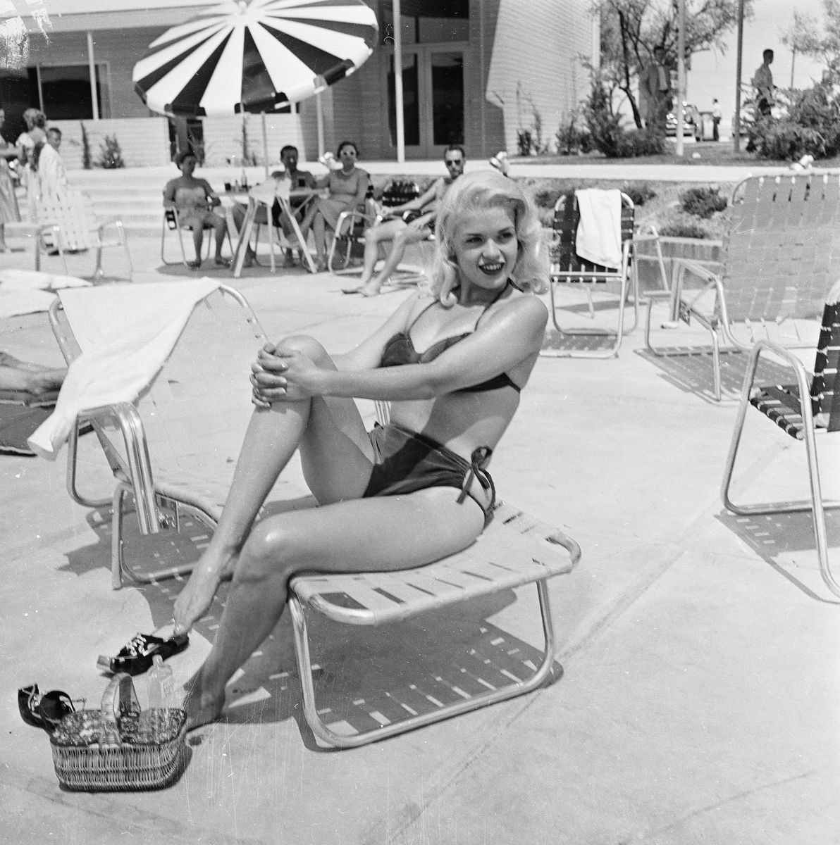 Slide 17 of 50: Actress Jayne Mansfield poses by the pool of the Dunes hotel in 1955. She died in a car accident at the age of 34.