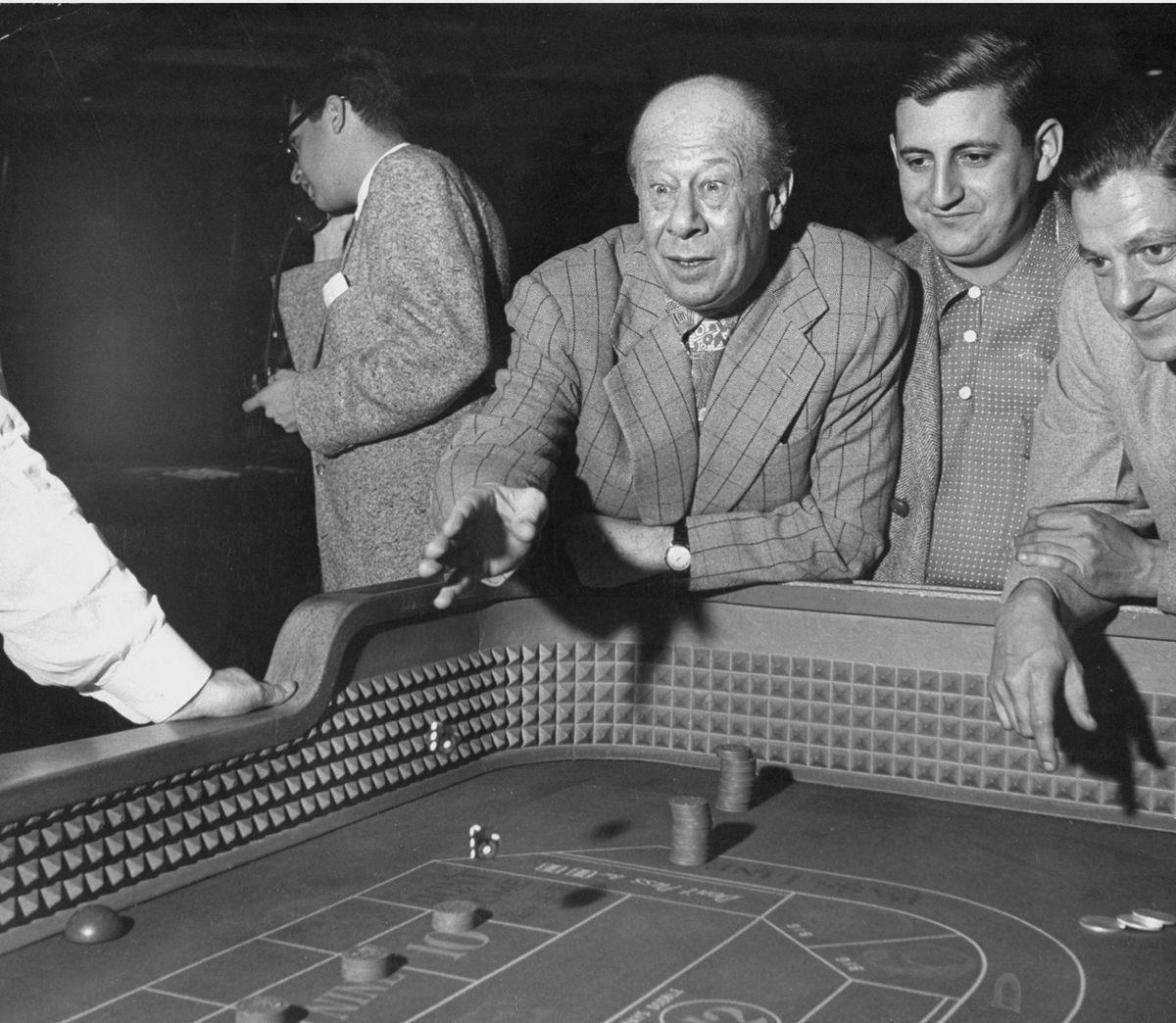 Slide 18 of 50: Bert Lahr plays dice in 1952. He is best known for his role as the Cowardly Lion in The Wizard of Oz.