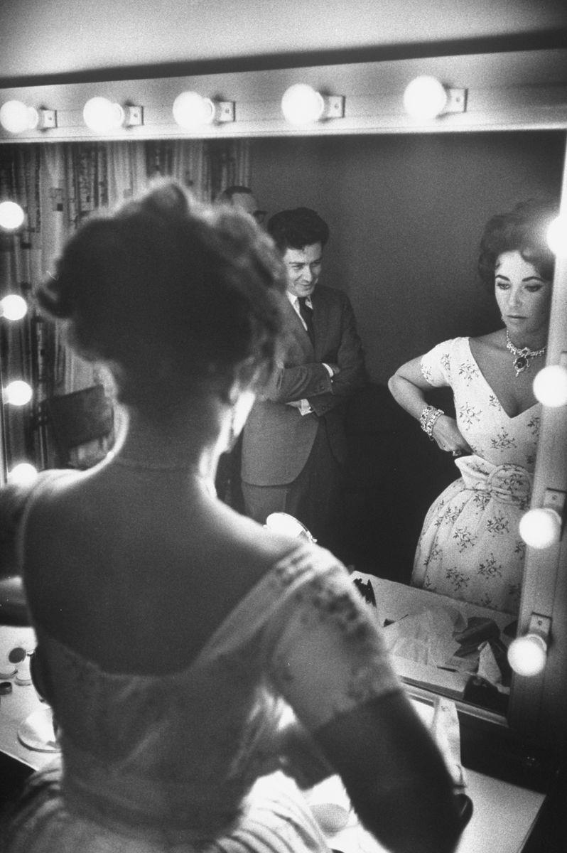 Slide 27 of 50: Eddie Fisher and Elizabeth Taylor before his show in 1959. Fisher's first wife, Debbie Reynolds, was Taylor's best friend at the time of his first marriage.