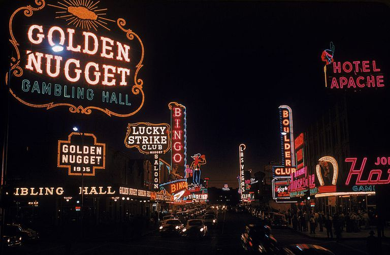 Slide 31 of 50: Fremont Street in Las Vegas at night in 1955. The Golden Nugget is a luxury hotel and was the largest casino in the downtown area—it's also the oldest casino still in operation today.