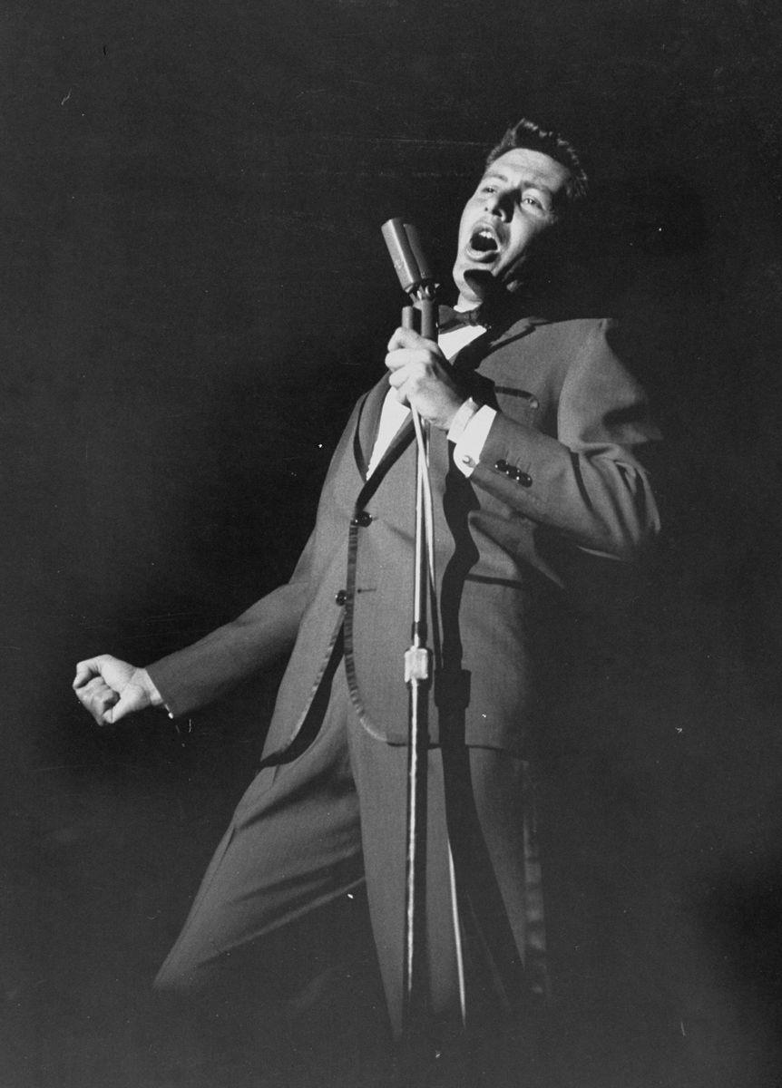 Slide 25 of 50: Eddie Fisher performs in 1958. He was one of the most popular artists during the '50s and even hosted his own TV show.
