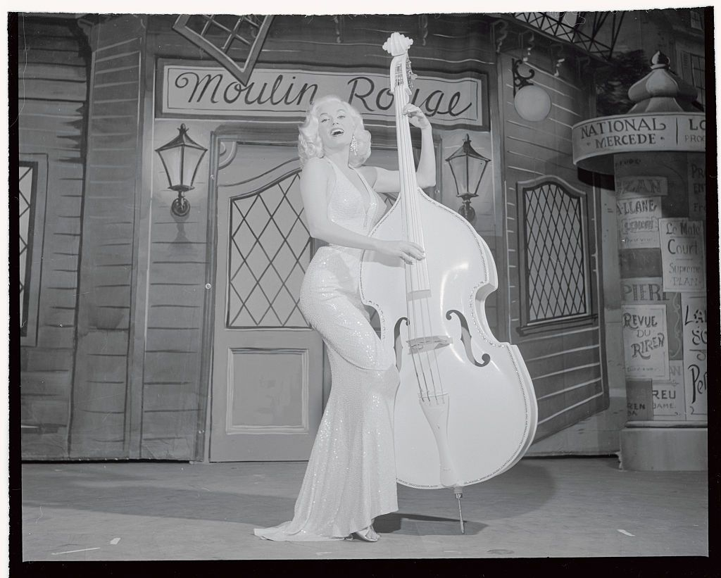 "Slide 4 of 50: Mamie Van Doren sings ""Teddy Bear"" during her first night club appearance at the Riviera Hotel in 1957. The sex symbol is known for being one of the first actresses to imitate the look of Marilyn Monroe."