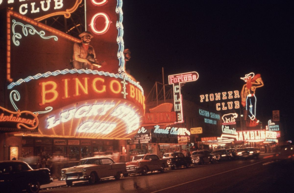 Slide 9 of 50: Fremont Street at night in 1955. It is among the most famous streets in the Las Vegas Valley, besides the Las Vegas Strip.
