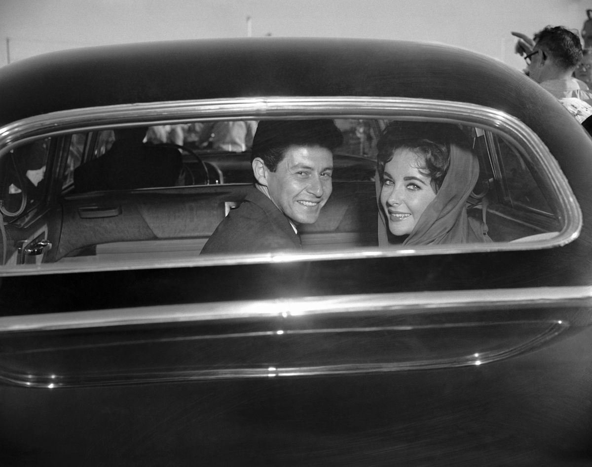 Slide 29 of 50: Eddie Fisher and Elizabeth Taylor leaving their wedding in 1959. Fisher and Taylor would divorce in 1964.