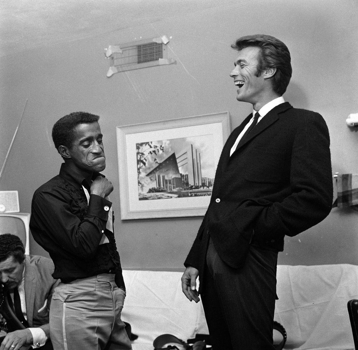 Slide 28 of 50: Sammy Davis Jr. and Clint Eastwood at the Sands hotel in 1959. Davis was instrumental in bringing a change in racial policy at the Sands.