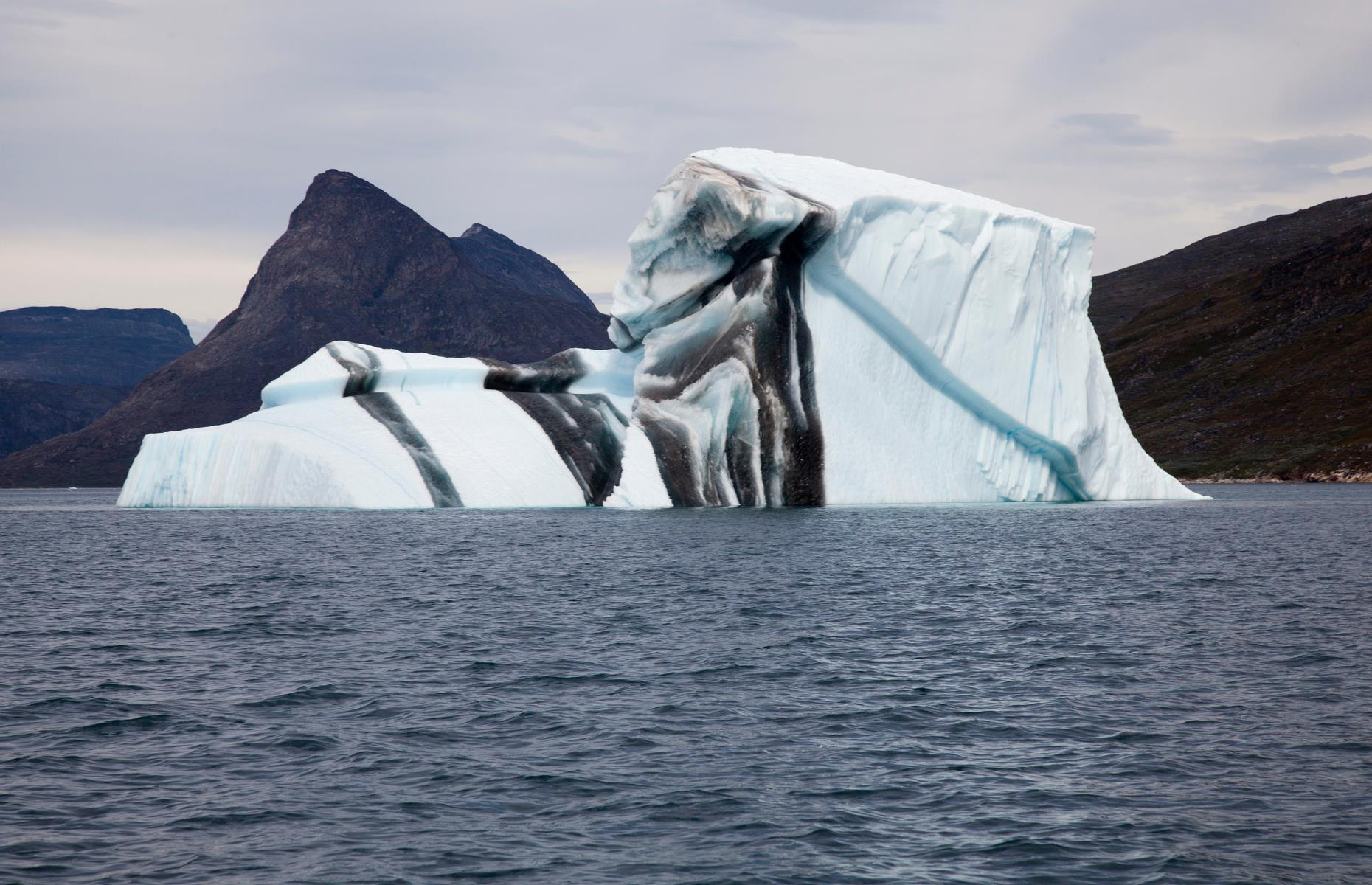 Slide 10 of 37: As if icebergs weren't awesome enough already, throw in some stripes and marbling, and they're almost too dazzling. The patterns form when cracks appear in the icy mass and are flooded with seawater that freezes.
