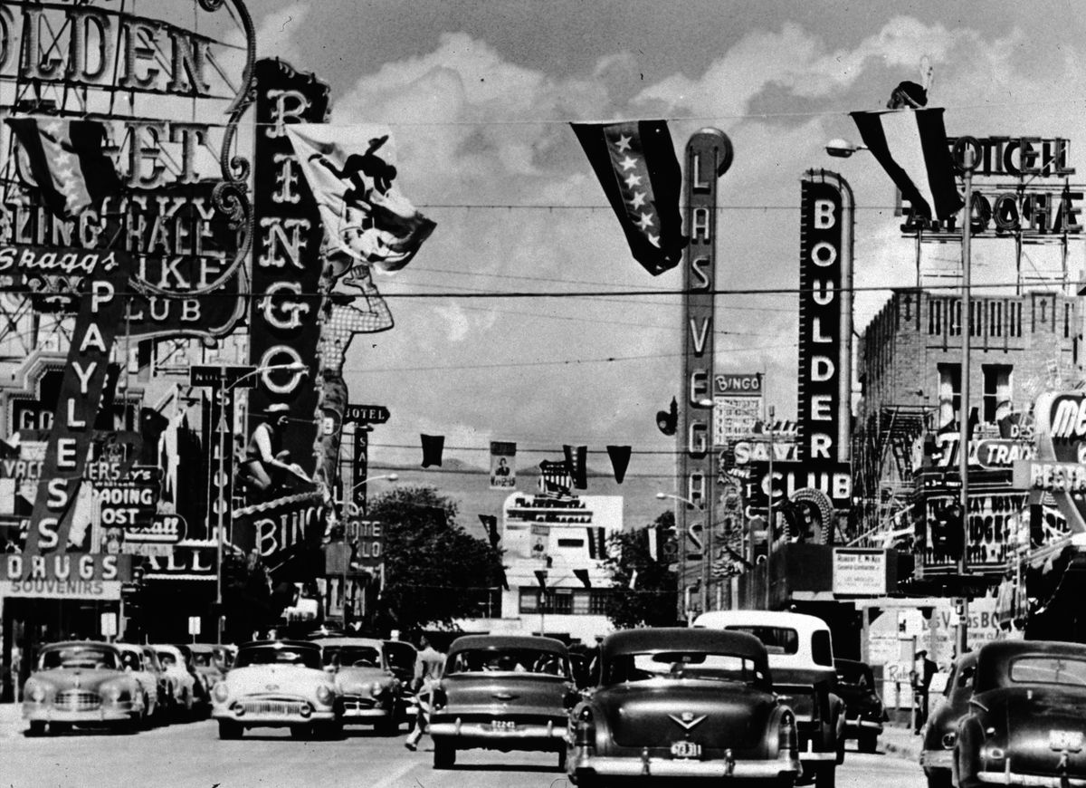 Slide 6 of 50: Cars drive down Fremont Street in Las Vegas in 1955. The street was named in honor of explorer John Charles Frémont and is located in the main downtown casino corridor.