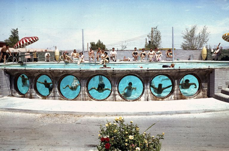 Slide 32 of 50: Swimmers look through underwater portholes in a pool at a Las Vegas hotel in 1955. Pools were a must, even in the '50s, since temps in the summer can easily surpass 100 degrees Fahrenheit.