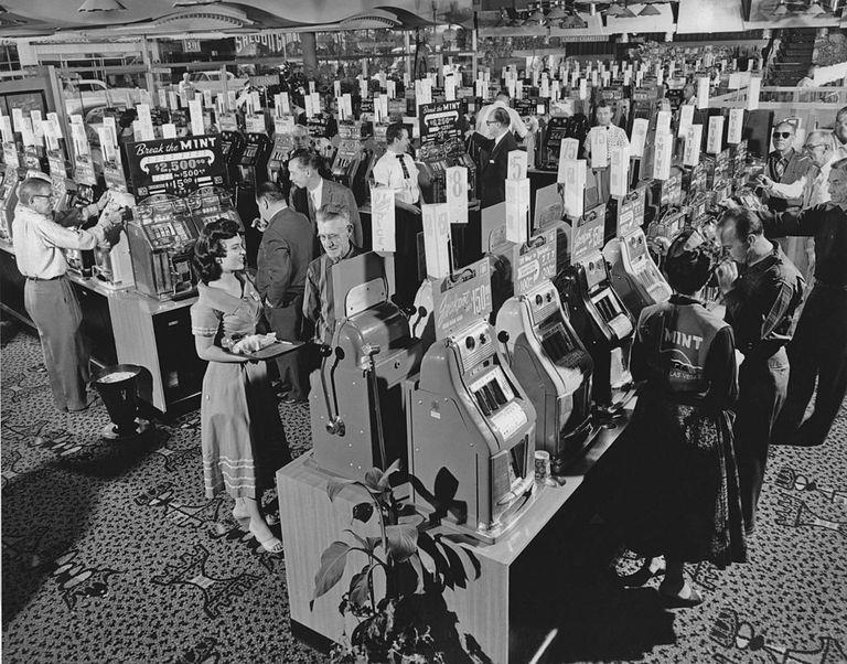 Slide 39 of 50: Gamblers at The Mint casino in 1958. This is the same casino that was featured in the 1972 novel by Hunter S. Thompson, Fear and Loathing in Las Vegas.