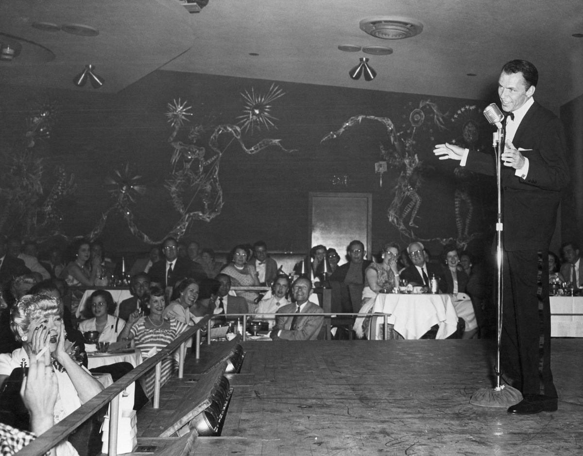 Slide 5 of 50: Frank Sinatra performs at the Sands in 1954. He typically played at Sands three times a year, sometimes a two-week stint, which brought in a lot of business.
