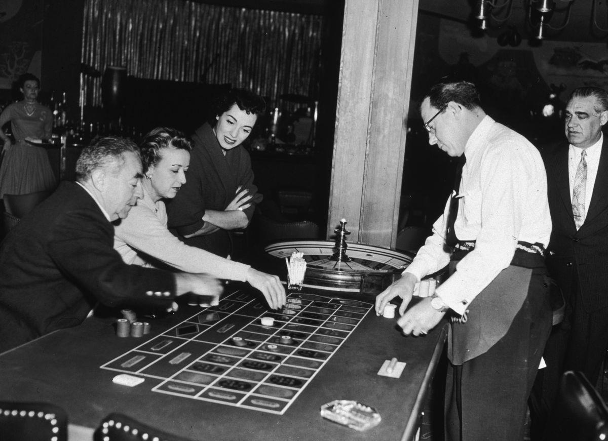 Slide 13 of 50: Opera singer Marguerite Piazza watches guests play roulette at the Sands in 1955. After her opera career she joined the supper-club circuit, performing jazz and pop in venues like the Sands in Las Vegas.