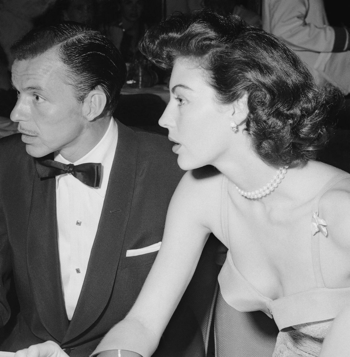 Slide 15 of 50: Frank Sinatra and actress Ava Gardner at the opening of his nightclub in 1951. The couple got married that year.